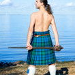 Mwith naked torso in kilt — Stock Photo #7448446