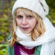 Blond woman in the white cap and scarf — Stock Photo