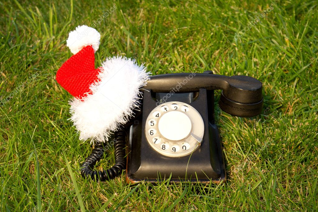 Old fashioned black telephone with Santa's hat  Stock Photo #6849996