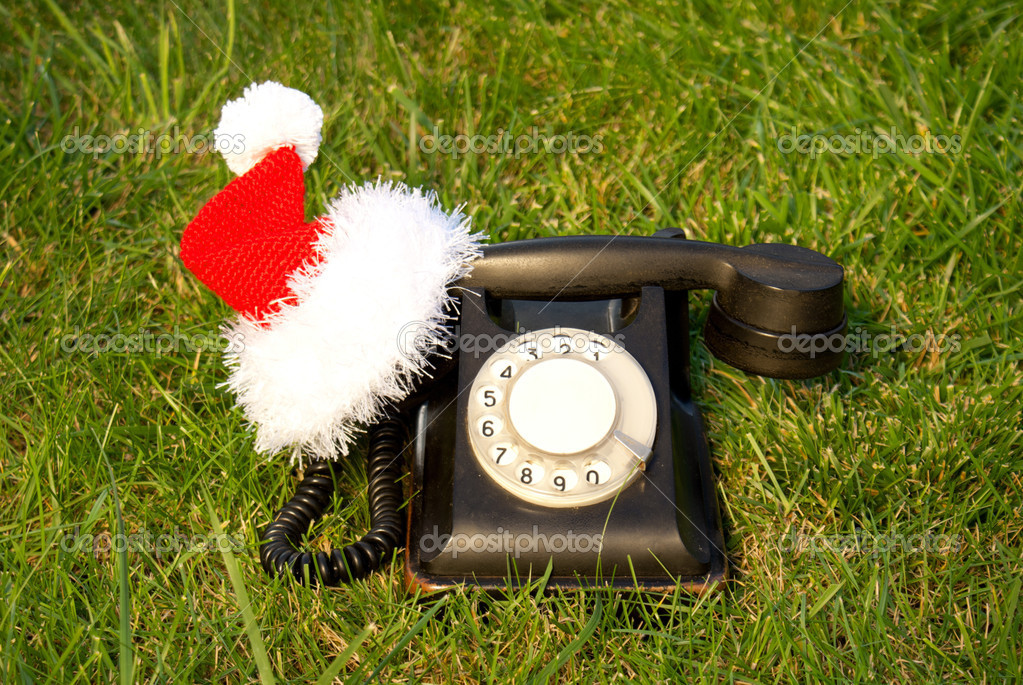 Old fashioned black telephone with Santa's hat — Stock Photo #6849996