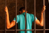 Man behind the bars — Stock Photo