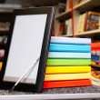 Stack of colorful books with electronic book reader — Stock Photo #7227283