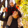 Happy father and son at fall time — Stock Photo