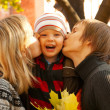 Happy family of three at fall time — Stock Photo