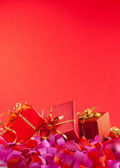 Christmas gifts over red background — Stok fotoğraf