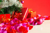 Christmas gifts over red background — Photo