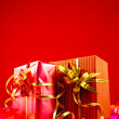Presents in red boxes against red background — Stock Photo