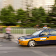Постер, плакат: Intentional motion blur of Beijing taxi car