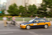Intentional motion blur of Beijing taxi car — Stock Photo