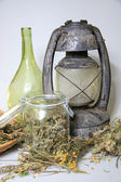 Still live, old oil lamp,dried herbs — Stock Photo