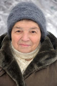 Portrait of a old woman in winter — Stock Photo