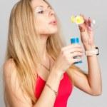 Pretty girl with soap bubbles — Stock Photo #6787747