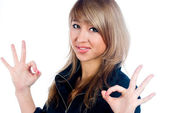 Girl showing thumb up gesture — Stock Photo
