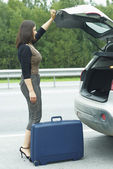 Woman with suitcase — Stock Photo