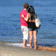 Yong cople on a beach — Stock Photo