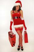 Sexy santa mit geschenken — Stockfoto