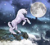 Beautiful unicorn over a rock — Stock Photo
