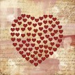 Heart on a vintage paper — Stock Photo