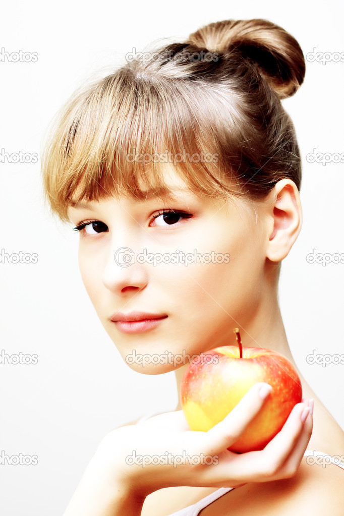 Beautiful girl holding red apple in the hand — Stock Photo #7239726