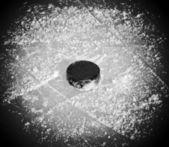 Puck on ice — Stock Photo