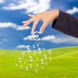 Royalty-Free Stock Photo: Hand bring up big euro sign