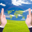 Green world map in business man hand — Stock Photo