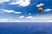 Colorful hot air balloon on the sea — Стоковое фото