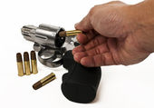 Put bullet into revolver gun isolated on white background — Stock Photo