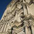 Постер, плакат: Spanish architecture A fragment of an old building against the blue sky
