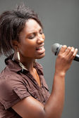 Black Woman Singing Into Microphone — Stock Photo