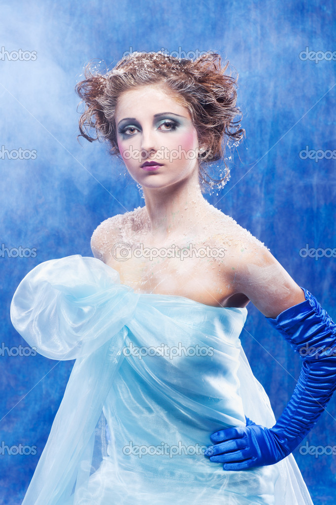 Fantasy portrait of beautiful young woman imaging ice fairy on frozen blue  Stock Photo #7827528