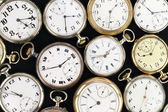 Various Antique pocket clocks on black background — Stock Photo