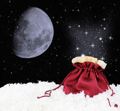 Magic satin sack on snow — Stock Photo