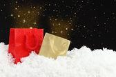 Magic christmas Shopping bags on snow — Stock Photo