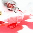 Broken wine glass and spilled red wine — Stock Photo