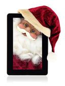 Santa Claus in the Christmas tablet — Stock Photo