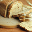 Loaf of fresh sliced bread - Stock Photo