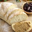 Fresh bread with olive tapenade — Stock Photo