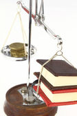 Money and books on balance scale — Stock Photo