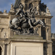 Louis XIV Statue at Louvre Art Museum, Paris - Stock Photo