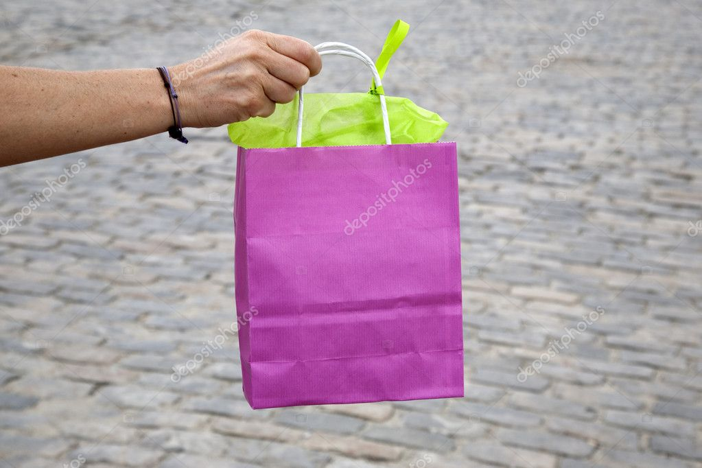 Pink Shopping Bag Held by a Woman — Stock Photo #6925214