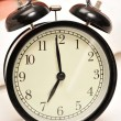 Stock Photo: Closeup of beautiful retro style alarm clock inside bedroom. Sle