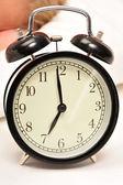 Closeup of beautiful retro style alarm clock inside bedroom. Sle — Stock Photo
