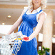 Photo of young joyful woman with shopping bags inside mall drivi — Stock Photo #6858856