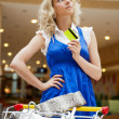Photo of young joyful woman with shopping bags inside mall drivi — Stock Photo