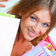 Closeup portrait of young happy woman with shopping bags at mall — Stock Photo #6859023