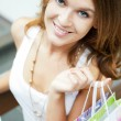 Happy shopping woman with bags and smiling. She is shopping insi — Stock Photo #6859070
