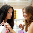Two excited shopping woman together inside shopping mall. Horizo — Stock Photo #6859085