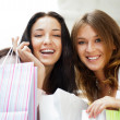 Two excited shopping woman together inside shopping mall. Horizo — Stock Photo #6859088