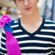 Portrait of young man inside shopping mall standing relaxed and — Stock Photo #6859103